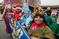 Paraders march in the annual Three Kings Day Parade in the Bushwick neighborhood of Brooklyn on Sunday, January 8, 2012. Neighborhood school children marched with residents, camels and kings in their celebration of the Epiphany. Many in the Latino community celebrate the traditional December 25 Christmas and the Epiphany. (© Richard B. Levine)