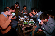 April 15th, 1989, Poyang, Jiangxi Province, China. Members of a traveling opera troupe during a rare moment of eating and resting.