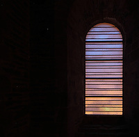 Stained glass window by Pierre Soulages, 1987-94, in the Abbatiale Sainte-Foy de Conques or Abbey-church of Saint-Foy, Conques, Aveyron, Midi-Pyrenees, France, a Romanesque abbey church begun 1050 under abbot Odolric to house the remains of St Foy, a 4th century female martyr. The glass used by Soulages is colourless and translucent, diffusing the light from outside without influencing the natural colours of the stone inside. The church is on the pilgrimage route to Santiago da Compostela, and is listed as a historic monument and a UNESCO World Heritage Site. Picture by Manuel Cohen