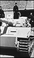 BNPS.co.uk (01202 558833)<br /> Pic: TankMuseum/BNPS<br /> <br /> Tiger Tanks during World War II.<br /> <br /> This is the poignant moment two German Tiger tank drivers and their British counterparts met for the first time 72 years after they fought on opposite sides in the Second World War.<br /> <br /> Wilhelm Fischer and Waldemar Pliska helped instill terror in British troops by manning the fearsome fighting machines and unleashing hell with their huge 88mm guns.<br /> <br /> Two of the enemy with first hand experiences of the heavily armoured Tigers were British tank men Ernest Slarks and Dr Ken Tout.<br /> <br /> Now aged in their 90s the four old foes became friends when they assembled for the launch of an historic exhibition at the Tank Museum in Bovington, Dorset.