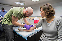 Shane Greene, left, takes blood from classmate Emily Keller for a lipid panel as the students learn how to perform a cardiovascular risk assesment as part of the Nutrition Metabolism and Gastrointestinal Systems class.