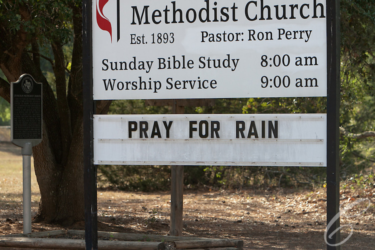 """The  sign outside the Seaton United Methodist Church in the evacuation zone urges passers-by to """"Pray for Rain.""""  The hoped for rain failed to fall on the Dyer Mill fire in Grimes County, Texas on June 21, 2011."""