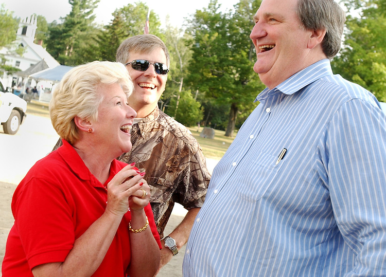 smith03/073002 - Sen. Bob Smith, R-N.H., sahres a laugh with supporters at the Hebron Old Home Day in Hebron, New Hampshire.
