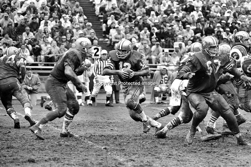 San Francisco 49ers vs the Los Angles Rams , quarterback John Brodie ready to hand off to back.<br />