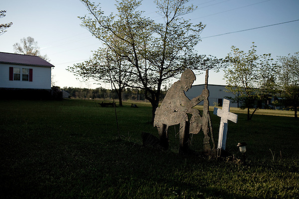 April 16, 2009. Lillington, NC.. A roadside sign depicting the image of a US soldier and a cross.