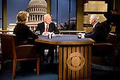 Washington, DC - December 6, 2009 -- United States Secretary of Defense Robert M. Gates and Secretary of State Hillary Clinton talk with CBS's Face the Nation host Bob Schieffer in Washington, D.C., Sunday, December 6, 2009.  This was the first time that the two cabinet members had appeared on Sunday morning talk shows together.  .Mandatory Credit: Cherie Cullen - DoD via CNP