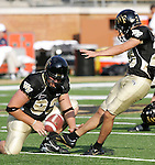 2 September 2006: Wake Forest place kicker Jon Temple (right) practices field goals, pregame. Wake Forest defeated Syracuse 20-10 at Groves Stadium in Winston-Salem, North Carolina in an NCAA college football game.