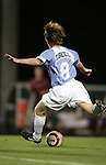 Dax McCarty, of UNC, takes a shot on Tuesday October 4th, 2005 at Fetzer Field on the campus of the University of North Carolina Chapel Hill in Chapel Hill, North Carolina. The UNC Tarheels defeated the Elon University Phoenix 2-1 after overtime in an NCAA Division I Men's Soccer game.