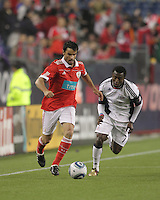 SL Benfica defender Luis Filipe (22) moves down the wing as New England Revolution forward/midfielder Kenny Mansally (7) pursues. SL Benfica  defeated New England Revolution, 4-0, at Gillette Stadium on May 19, 2010.