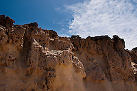The shore area of Puerto de la Pena, Aiuy, has large limestone deposits with a rugged and eroded appearance. Fuerteventura, Canary Islands, Spain