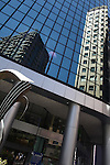 Two buildings are reflected in the windows of a skyscraper in Melbourne, Australia. Nov. 23, 2012.