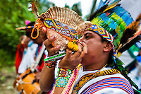 """A native from the Kamentsá tribe, wearing a colorful feather headgear, plays pututo (a shell trumpet) during the Carnival of Forgiveness, a traditional indigenous celebration in Sibundoy, Colombia, 12 February 2013. Clestrinye (""""Carnaval del Perdón"""") is a ritual ceremony kept for centuries in the Valley of Sibundoy in Putumayo (the Amazonian department of Colombia), a home to two closely allied indigenous groups, the Inga and Kamentsá. Although the festival has indigenous origins, the Catholic religion elements have been introduced and merged with the shamanistic tradition. Celebrating annually the collaboration, peace and unity between tribes, they believe that anyone who offended anyone may ask for forgiveness this day and all of them should grant pardons."""