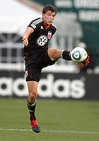 Marc Burch #4 of D.C. United pulls down a high ball during an international charity match against the national team of El Salvador at RFK Stadium, on June 19 2010 in Washington DC. D.C. United won 1-0.