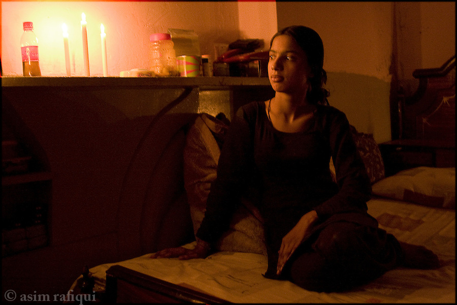 a young dancer/entertainer rimshah in her bedroom during a lahore evening blackout