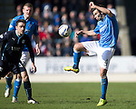 St Johnstone v Dundee....11.04.15   SPFL<br /> Simon Lappin clears from Paul Heffernan<br /> Picture by Graeme Hart.<br /> Copyright Perthshire Picture Agency<br /> Tel: 01738 623350  Mobile: 07990 594431