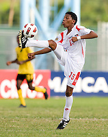 Romario Piggott (15) of Panama takes the ball down during the third place game of the CONCACAF Men's Under 17 Championship at Catherine Hall Stadium in Montego Bay, Jamaica. Panama defeated Jamaica, 1-0.