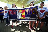 Phoenix, Arizona (March 29, 2014) - A group of women holds a banner supporting the pro-choice movement. The sign is sponsored by Arizona NARAL Pro-Choice America, a lobby group pressuring the U.S. Congress for pro-choice legislation. Photo by Eduardo Barraza © 2014