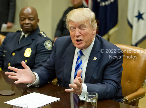 United States President Donald J. Trump makes remarks as he meets with the I-85 bridge first responders in the Roosevelt Room of the White House in Washington, DC on Thursday, April 13, 2017.<br /> Credit: Ron Sachs / Pool via CNP
