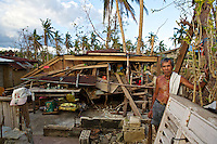 Heram stands by what once was his house. Typhoon Yolanda destroyed many houses in Dapdap, Camotes Islands. Luckily in this part of the country casualties were low.