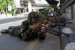 Thai soldiers prepare to move into the Red-shirt camp in Lumpini Park during the military crackdown to end the Red-shirt protests.