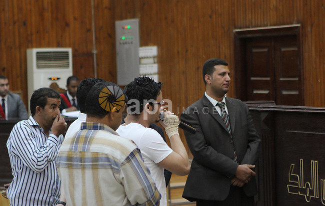Members of Egyptian 'Ultras of Raba'wi' attend their trial in a court in Cairo, on May 24, 2015. Photo by Stringer