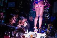 Go Go dancers perform on the bar, above the drinkers, at the ZaZa Club