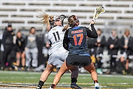 Towson, MD - March 5, 2017: Towson Tigers Natalie Sulmonte (11) and Florida Gators Mollie Stevens (17) fights for the faceoff during game between Towson and Florida at  Minnegan Field at Johnny Unitas Stadium  in Towson, MD. March 5, 2017.  (Photo by Elliott Brown/Media Images International)