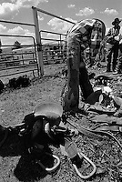 A saddle-bronc rider prepares for competition at the annual Lincoln Rodeo in Lincoln, MT in June 2006.  The Lincoln Rodeo is an open rodeo, which means competitors need not be a member of a professional rodeo association.