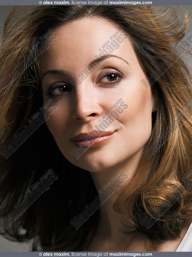 Portrait of a beautiful smiling woman with daydreaming expression closeup of face