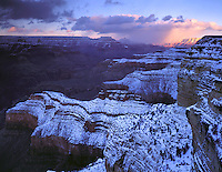 Grand Canyon National Park, AZ   <br /> Distant sunbreak on South Rim under winter evening storm from Mohave Point