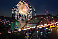 Colorful 4th of July fireworks explode over the 360 Bridge over Lake Austin. Boats and watercraft park on Lake Austin to witness the annual spectacle hosted by the Austin Country Club.