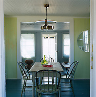 Painted floors and walls in bright new colours update the 1920s structure of this beach house