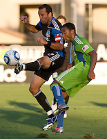 Ramiro Corrales of Earthquakes fights for the ball against James Riley during the game at Buck Shaw Stadium in Santa Clara, California on July 31st, 2010.   Seattle Sounders defeated San Jose Earthquakes, 1-0.