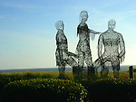 A sculpture of people silouetted against the Pacific Ocean decorate a beach neighborhood near Cannon Beach, Oregon.
