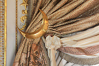 """Detail of curtain tie backs crescent moon shapped, Turkish Boudoir, redesigned in 1777 for Marie Antoinette, by architect Richard Mique, Chateau de Fontainebleau, France. The decoration is the achievement of the brothers Rousseau, and the furniture dates to the period of the First Empire, with precious textile work done by Jacob-Desmalter for Empress Josephine. Including a small bedroom, mirrors, and curtains raised by pulleys, this exceptional ensemble has been restored in 2014 thanks to the support of INSEAD and the generosity of subscribers of sponsors belonging to the group """"Des Mécènes pour Fontainebleau"""". Its opening to the public is schedule for Spring 2015. Picture by Manuel Cohen"""