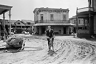 """Hollywood, Los Angeles, California, USA.1969. French actor and singer Yves Montand bicycling on the set of a western movie in Hollywood. Montand was an immensely popular nightclub singer and movie actor and most famous for his dramatic role in the 1953 thriller """"The Wages of Fear""""."""