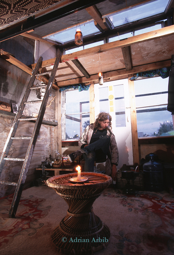 Dave inside his house built from skip found  scrap. Wandsworth Eco village.