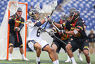 Annapolis, MD - February 11, 2017: Navy Midshipmen Greyson Torain (6) gets hit by several Maryland Terrapins defenders during game between Maryland vs Navy at  Navy-Marine Corps Memorial Stadium in Annapolis, MD.   (Photo by Elliott Brown/Media Images International)