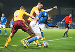 St Johnstone v Motherwell....31.10.14   SPFL<br /> Brian Graham is tackled by Mark O'Brien<br /> Picture by Graeme Hart.<br /> Copyright Perthshire Picture Agency<br /> Tel: 01738 623350  Mobile: 07990 594431