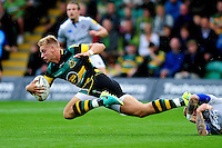 Harry Mallinder of Northampton Saints is tackled to ground by Tom Homer of Bath Rugby. Aviva Premiership match, between Northampton Saints and Bath Rugby on September 3, 2016 at Franklin's Gardens in Northampton, England. Photo by: Patrick Khachfe / Onside Images