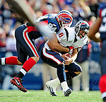 1 November 2009: Houston Texans' quarterback Matt Schaub is sacked for an 11 yard loss in the first quarter by Buffalo Bills defensive end Aaron Schobel at Ralph Wilson Stadium in Orchard Park, New York, United States of America. The Texans defeated the Bills 31-10. Mandatory Credit: Ed Wolfstein Photo