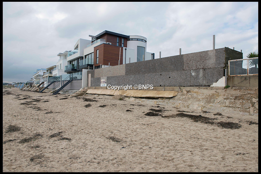 BNPS.co.uk (01202 558833)<br /> Pic: LauraDale/BNPS<br /> <br /> Boarded up: The back of the plot, which faces out onto Sandbanks beach.<br /> <br /> A narrow empty plot of land in the world-renowned Sandbanks area is on the market for &pound;6.25million.<br /> <br /> The piece of land is worth &pound;2m more now its empty than it was when the owner bought it with two semi-detached houses on it.<br /> <br /> The area in Dorset, often called Millionaire's Row, is said to be the fourth most expensive place in the world to live and this plot is one of the few left to redevelop.