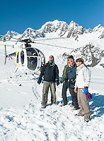 Group of tourists on scenic flight landing in Southern Alps with Fox Glacier, Westland Tai Poutini National Park, West Coast, South Westland,  UNESCO World Heritage Area, New Zealand, NZ