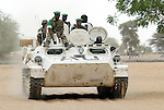 African Union troops from Nigeria on patrol in the town of Labado, which was attacked by government military forces and Arab militias in December 2004, causing the town's 25,000 people to flee for their lives. The AU force was later absorbed into a larger UN force.