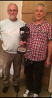 BNPS.co.uk (01202 558833)<br /> Pic: TonyFarrington/BNPS<br /> <br /> JohnTresidder (right) with Tony Farrington who lent him the metal detector.<br /> <br /> Married John Tressider got the needle when he lost his wedding ring in a giant haystack - only to find it two weeks later using a metal detector.John, 68, from East Budleigh, Devon, had been helping out on his auntie's farm and was moving 200 large bales of straw when he noticed his gold Celtic band had come off his finger.After two separate 'needle in a haystack' searches for it he borrowed a friend's metal detector and finally found it close to the bottom of the 20ft tall stack.