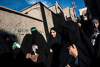 A group of women, wearing knotted veils, walk together during the 'Chehel Manbar' (Fourty Pulpit) ceremony held the day before Ashura in Khorramabad. Traditionally, Iranian women walk bare-footed to light 40 candles in designated places in the centre of the city starting early in the morning.