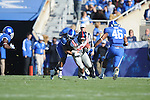 Ole Miss' Brandon Bolden (34) is tackled by Kentucky's Winston Guy (21) at Commonwealth Stadium in Lexington, Ky. on Saturday, November 5, 2011. Kentucky won 30-13...