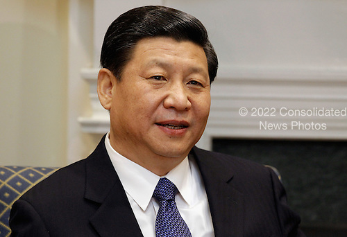 Vice President Xi Jinping of China makes brief remarks before an expanded bilateral meeting with United States Vice President Joe Biden and other U.S. and Chinese officials in the Roosevelt Room at the White House February 14, 2012 in Washington, DC. While in Washington, Vice President Xi will meet with Biden, President Barack Obama and other senior Administration officials to discuss a broad range of bilateral, regional, and global issues.  .Credit: Chip Somodevilla / Pool via CNP