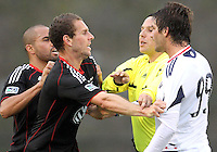 Fred#27 and Kurt Mosink#6 of D.C. United argue with Diego Chaves#99 of the Chicago Fire during a second round match of the Carolina Challenge on March 9 2011 at Blackbaud Stadium, in Charleston, South Carolina. D.C. United won 1-0.