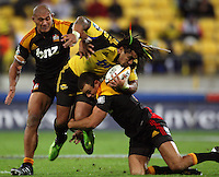 Chiefs centre Richard Kahui tackles Ma'a Nonu during the Super 14 rugby match between the Hurricanes and Chiefs at Westpac Stadium, Wellington, NewZealand on Saturday, 1 May 2010. Photo: Dave Lintott / lintottphoto.co.nz